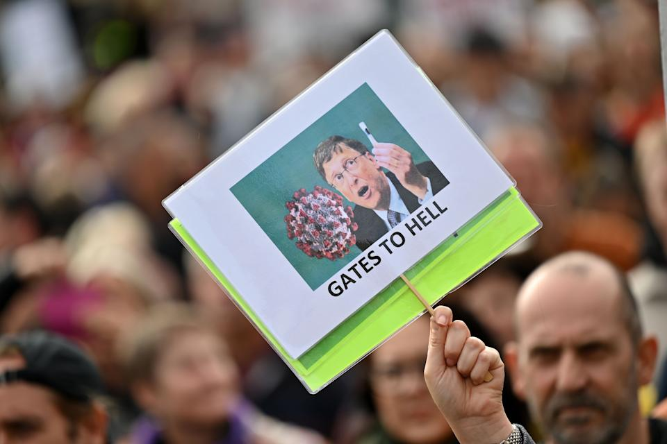 A protester holds up an anti-Bill Gates placard in Trafalgar Square in London on September 26, 2020, at a 'We Do Not Consent!' mass rally against vaccination and government restrictions designed to fight the spread of the novel coronavirus, including the wearing of masks and taking tests for the virus. (Photo by JUSTIN TALLIS / AFP) (Photo by JUSTIN TALLIS/AFP via Getty Images)