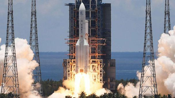 PHOTO: A Long March-5 rocket, carrying an orbiter, lander and rover as part of the Tianwen-1 mission to Mars, lifts off from the Wenchang Space Launch Center in southern China's Hainan Province on July 23, 2020. (Noel Celis/AFP via Getty Images, FILE)