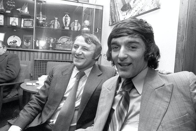 Docherty and Macari following his move from Celtic. They are pictured in Manchester after Macari had escaped injury in a car crash (PA Archive/PA Images)