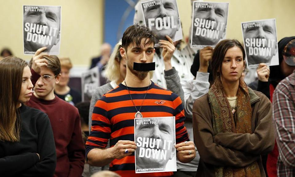 Protesters turn their backs on a meeting of the Virginia state air quality control board in Richmond, Virginia, in January 2019.