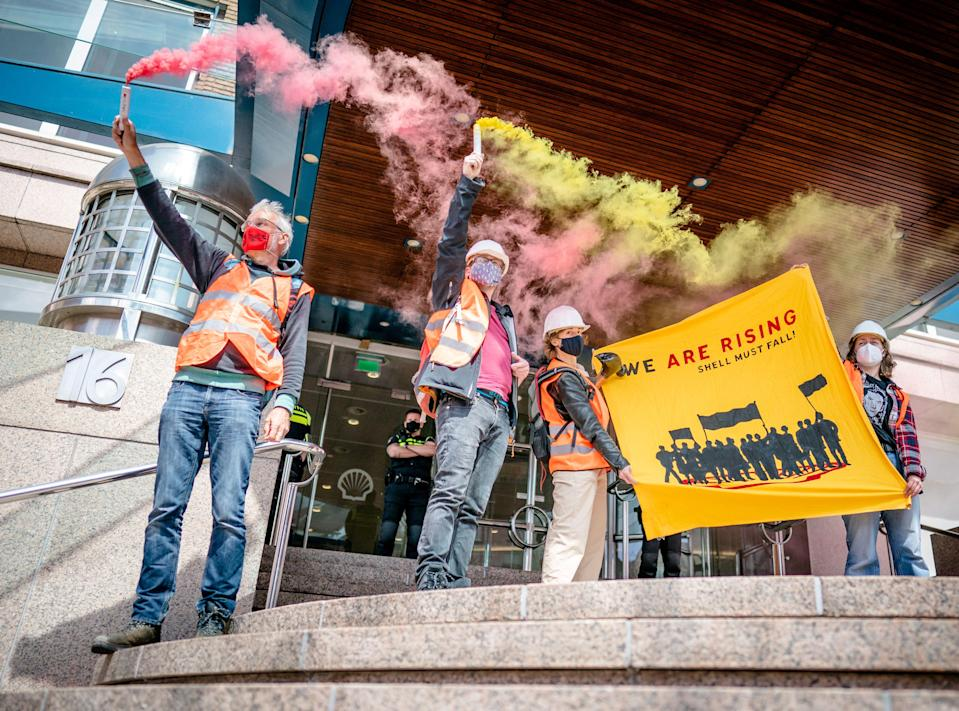 Activists protest outside of Shell's headquarters in The Hague on 18 May (ANP/AFP via Getty Images)