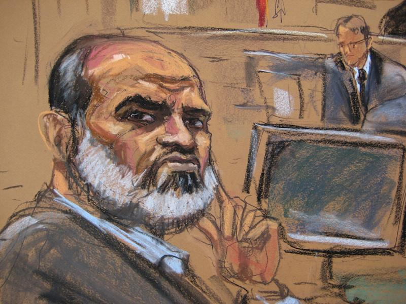 Suleiman Abu Ghaith listens during his trial in a federal court in New York