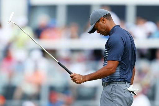 Tiger Woods of the US reacts on the 13th green during the first round of the 2018 US Open, at Shinnecock Hills Golf Club in Southampton, New York, on June 14