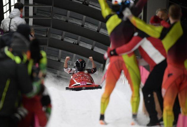 Canada's Alexander Kopacz and Justin Kripps celebrate at the finish line of the two-man bobsled.