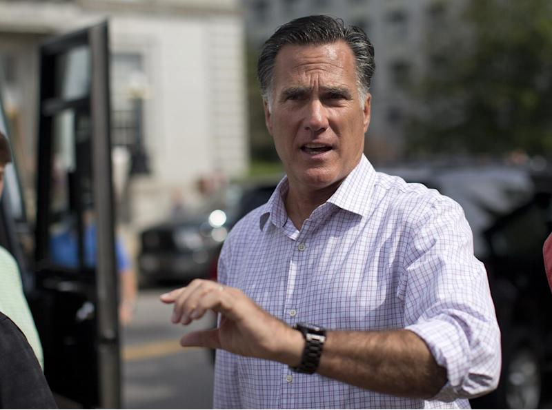 """Republican presidential candidate, former Massachusetts Gov. Mitt Romney speaks with the news media after making a stop at the """"New Hampshire Veterans and Military Families for Mitt"""" event in Concord, N.H., Thursday, Sept. 6, 2012.  (AP Photo/Evan Vucci)"""