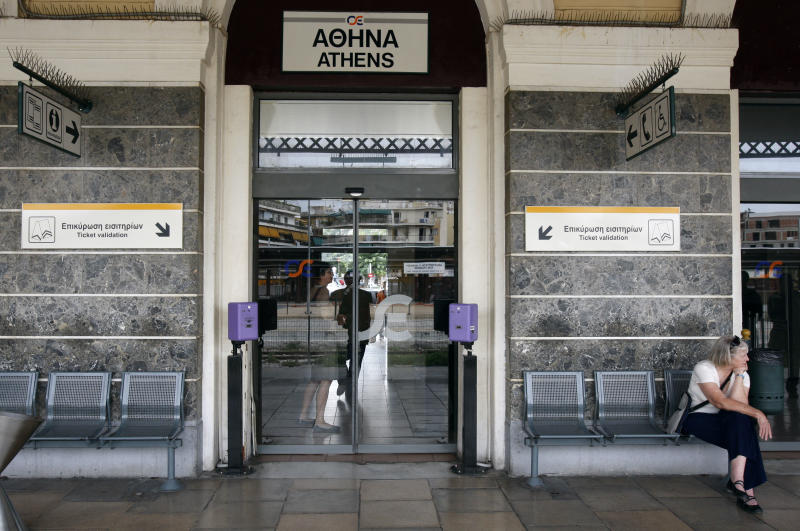 A tourist sits at the central Athens train station during a strike on Thursday, Oct. 14, 2010. A 24-hour strike was called by employees at the state-run National Railways to protest government plans to partially privatize the loss-making company. (AP Photo/Thanassis Stavrakis)