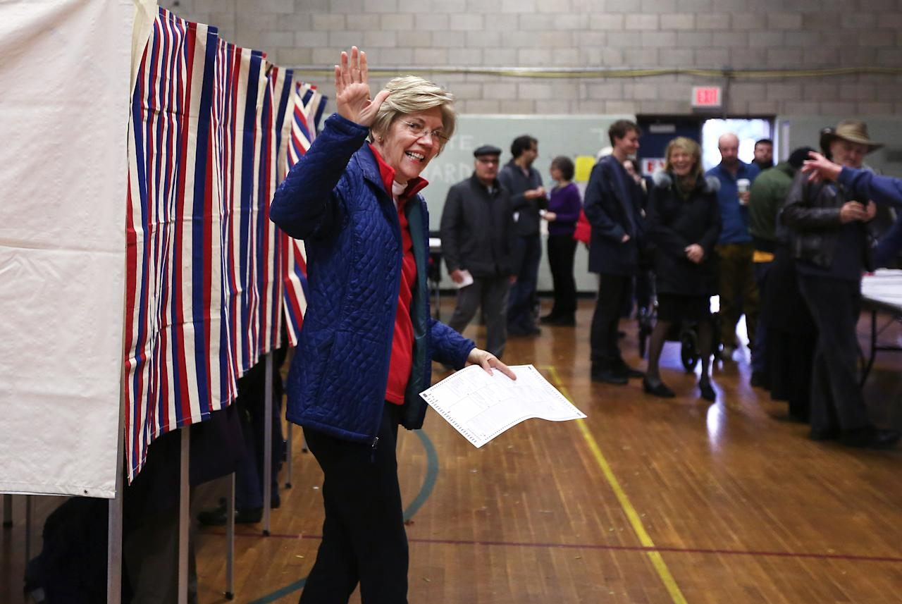 <p>Senator Elizabeth Warren emerges from the voting booth in Cambridge, Mass., on Election Day, Nov. 6, 2018. (Photo: Pat Greenhouse/The Boston Globe via Getty Images) </p>
