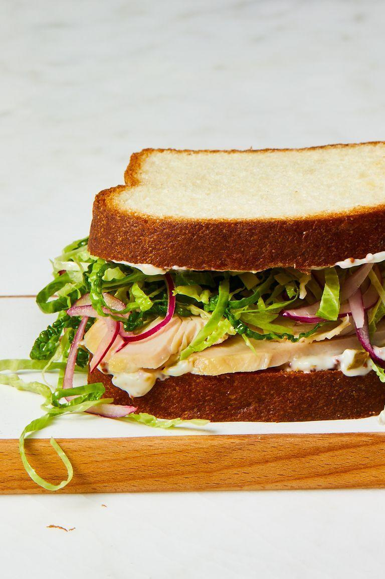 """<p>Dress up a slice of your holiday main (turkey!) with layers of lettuce, onion, and a spread of your choice. </p><p><em><a href=""""https://www.goodhousekeeping.com/food-recipes/easy/a29459746/leftover-turkey-sandwich-recipe/"""" rel=""""nofollow noopener"""" target=""""_blank"""" data-ylk=""""slk:Get the recipe for Turkey Sandwich »"""" class=""""link rapid-noclick-resp"""">Get the recipe for Turkey Sandwich »</a></em></p>"""
