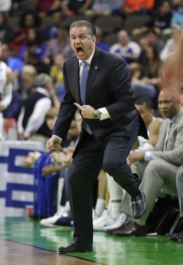 Kentucky coach John Calipari yells to his players during the first half against Abilene Christian in a first-round game in the NCAA mens college basketball tournament in Jacksonville, Fla. Thursday, March 21, 2019. (AP Photo/John Raoux)