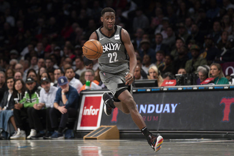 The Nets are still in the playoff field without Caris LeVert and Kyrie Irving. How much can those two players returning help? (AP Photo/Mary Altaffer)