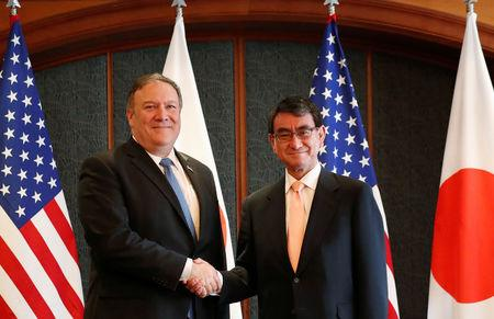 U.S. Secretary of State Mike Pompeo shakes hands with Japan's Foreign Minister Taro Kono during a bilateral meeting at a hotel in Seoul, South Korea June 14, 2018. REUTERS/Kim Hong-ji/Pool