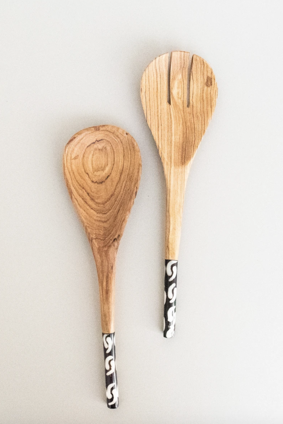 """<p><strong>Amani ya Juu</strong></p><p>amaniafrica.org</p><p><strong>$18.00</strong></p><p><a href=""""https://amaniafrica.org/collections/kitchen-and-home/products/thin-handle-spoon-set"""" rel=""""nofollow noopener"""" target=""""_blank"""" data-ylk=""""slk:SHOP IT"""" class=""""link rapid-noclick-resp"""">SHOP IT</a></p><p>Amani ya Juu, which means peace from above in Swahil, carries a range of goods from handbags to kitchen decor to jewelry. The products are made by women all over Africa with its motifs and colors. In addition to buying these handmade artisan goods, you can directly donate to any of the <a href=""""https://amaniafrica.org/pages/donate"""" rel=""""nofollow noopener"""" target=""""_blank"""" data-ylk=""""slk:brand's charities"""" class=""""link rapid-noclick-resp"""">brand's charities</a> of your choosing. </p>"""