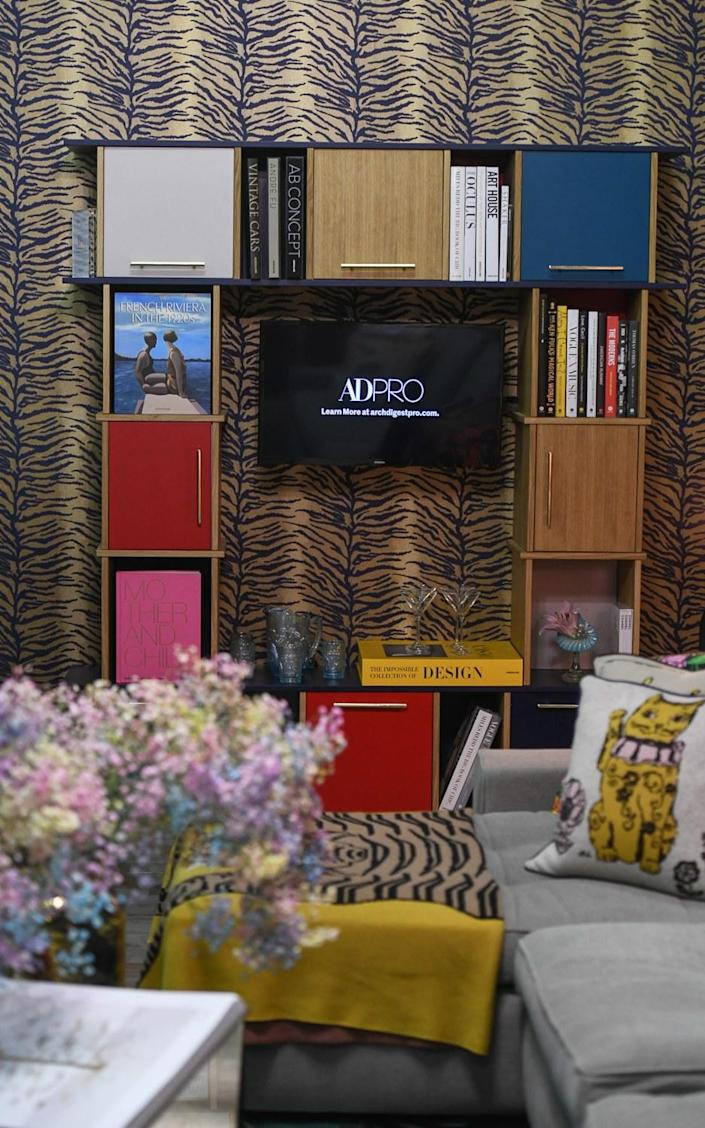 Bikoff adorned the custom Reform wall cabinet with brass Emtek hardware as well as books from Assouline and Abrams.