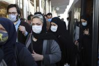FILE - In this Oct. 11, 2020, file photo, people wear protective face masks to help prevent the spread of the coronavirus in downtown Tehran, Iran. As coronavirus infections reached new heights in Iran, overwhelming its hospitals and driving up its death toll, the country's health minister gave a rare speech criticizing his own government's refusal to enforce basic health measures. (AP Photo/Ebrahim Noroozi, File)