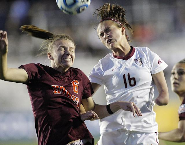 Virginia Tech's Jodie Zelensky (6) battles Florida State's Carson Pickett (16) for the ball during the first half of a semifinal match at the Women's College Cup soccer tournament in Cary, N.C., Friday, Dec. 6, 2013. (AP Photo/Ellen Ozier)