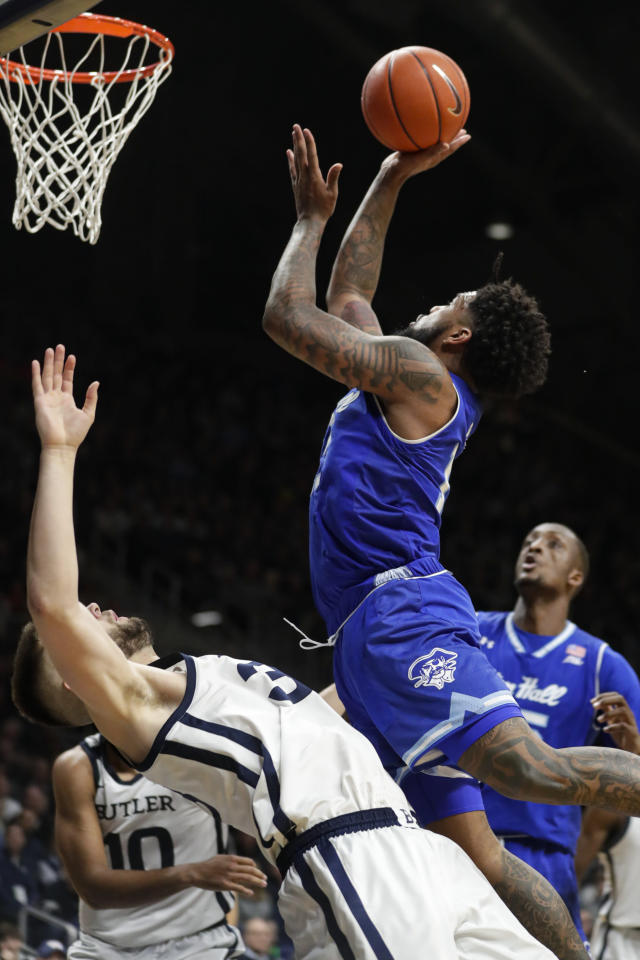 Seton Hall guard Myles Powell (13) shoots over Butler forward Bryce Golden (33) in the second half of an NCAA college basketball game in Indianapolis, Wednesday, Jan. 15, 2020. Seton Hall defeated Butler 78-70. (AP Photo/Michael Conroy)