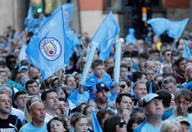 Soccer Football - Premier League - Manchester City Premier League Title Winners Parade - Manchester, Britain - May 14, 2018 Manchester City fans during the parade Action Images via Reuters/Andrew Boyers