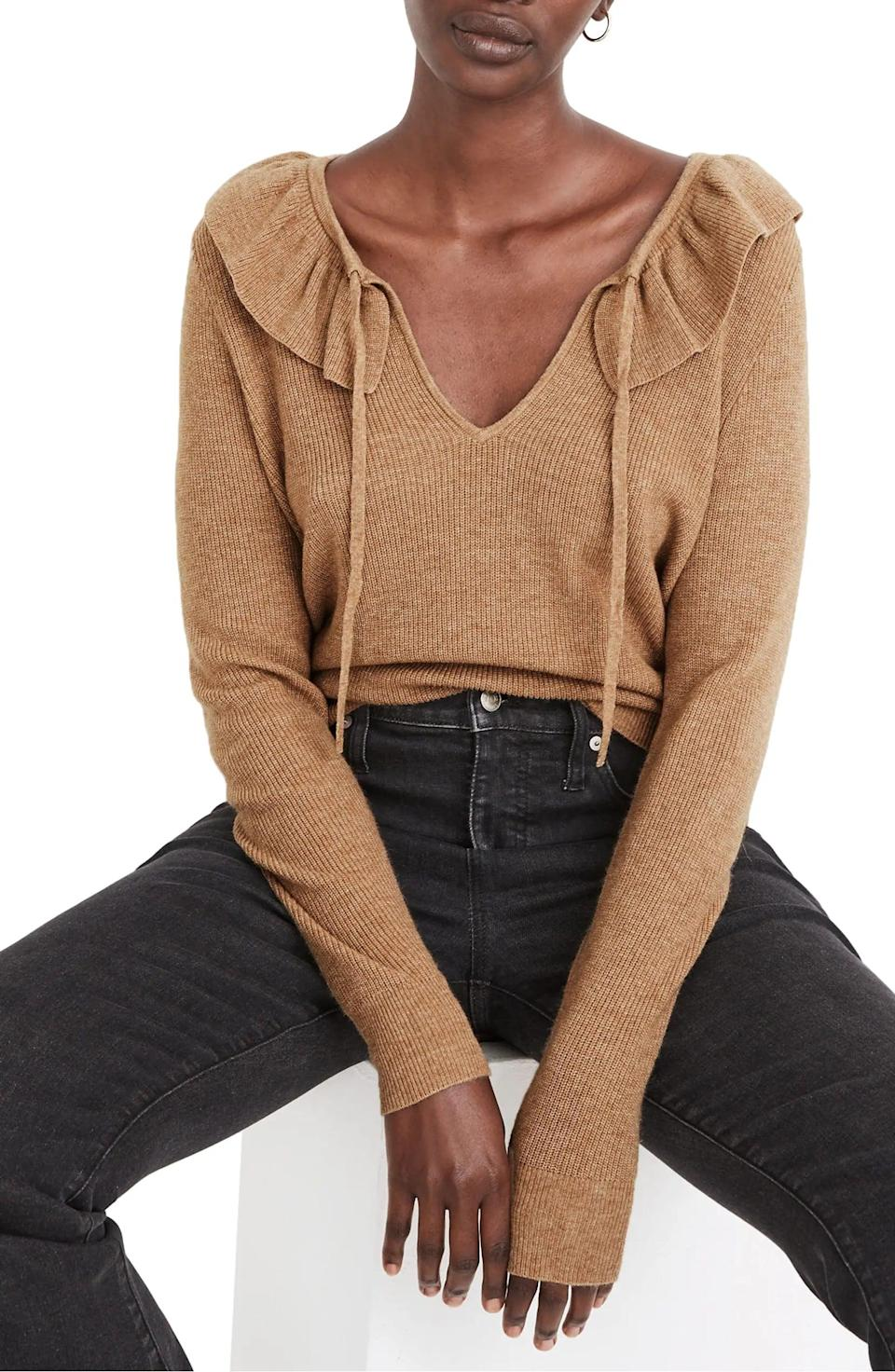 <p>The collar detail on this <span>Madewell Tie Neck Ruffle Pullover Sweater</span> ($70, originally $78) is so pretty.</p>
