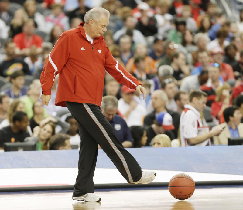 Wisconsin head coach Bo Ryan clears a ball from the floor during practice for an NCAA Final Four tournament college basketball semifinal game Friday, April 4, 2014, in Dallas. Wisconsin plays Kentucky on Saturday, April 5, 2014. (AP Photo/Charlie Neibergall)