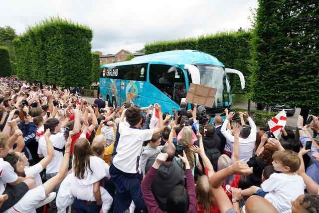 England fans cheer the bus leaving the hotel