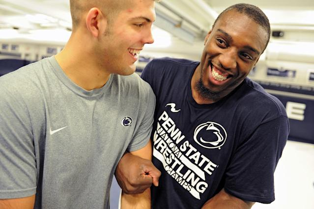 STATE COLLEGE, PA - NOVEMBER 07: UFC light heavyweight fighter Phil Davis jokes around with Penn State coach Quentin Wright during the '20 days to UFC 167' media tour at the Lorenzo Wrestling Complex on the campus of Penn State University on November 7, 2013 in State College, Pennsylvania. (Photo by Patrick Smith/Getty Images)