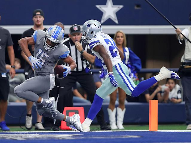 <p>Golden Tate #15 of the Detroit Lions scores a touchdown against Chidobe Awuzie #24 of the Dallas Cowboys in the fourth quarter of a game at AT&T Stadium on September 30, 2018 in Arlington, Texas. (Photo by Tom Pennington/Getty Images) </p>