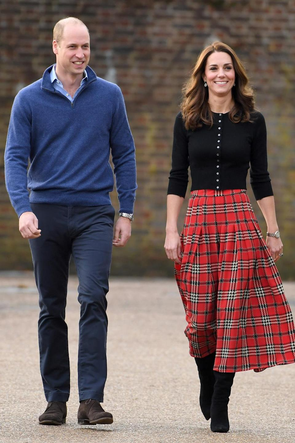 <p>Kate looked holiday-ready ahead of Christmas 2018, sporting a red and green midi skirt in the patterned cloth.</p>