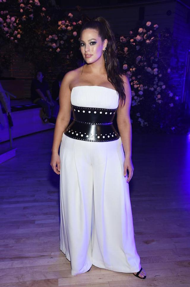 <p>Graham wore a white strapless jumpsuit with a wide black belt for a rare appearance off the runway. (Photo: Getty Images) </p>