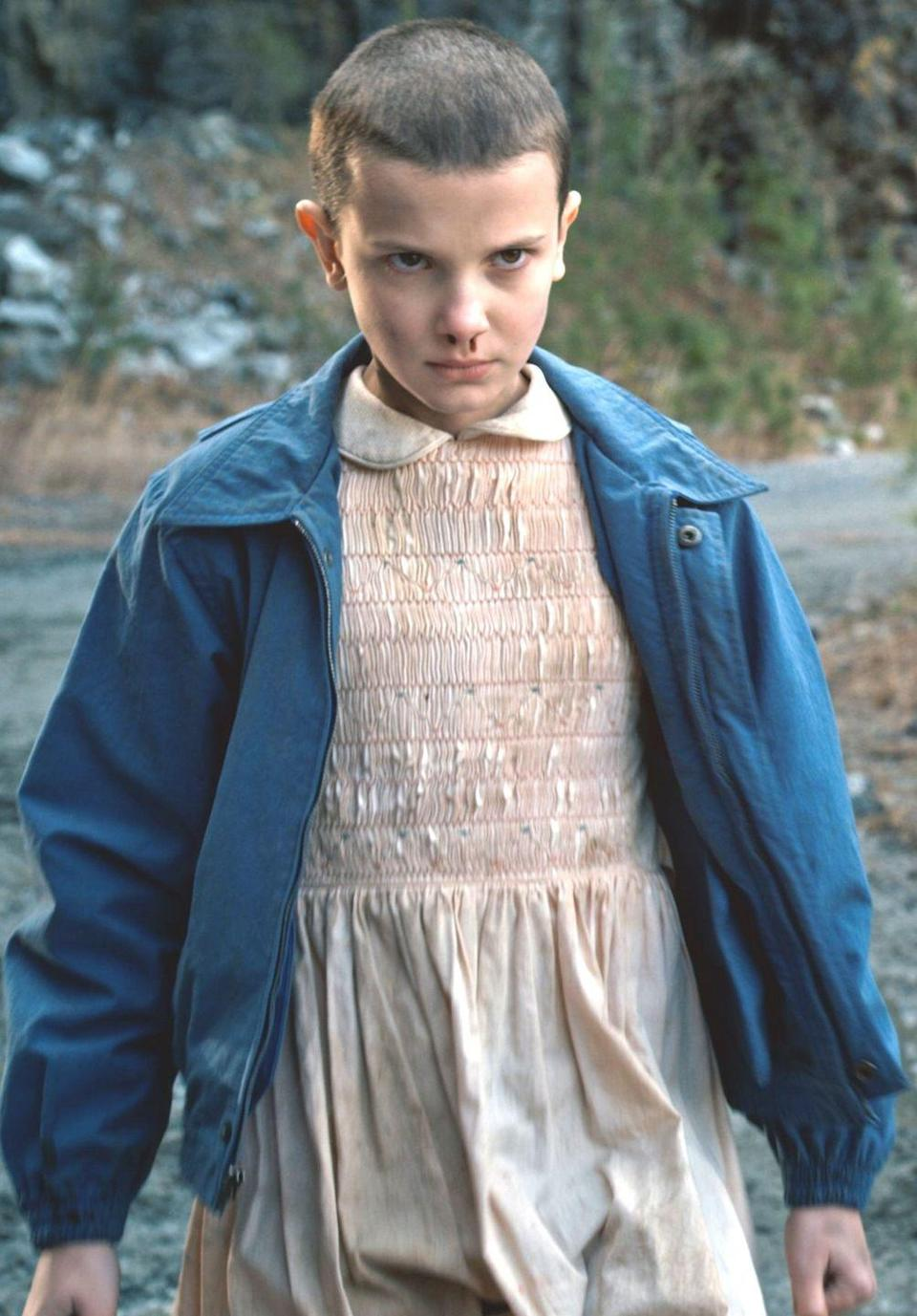 """<p><em>Stranger Things</em> fans will love this Eleven costume. Just pair a pink dress with a blue jacket and accessorize with a drop of fake blood and an Eggo box.</p><p><a class=""""link rapid-noclick-resp"""" href=""""https://www.amazon.com/Oulooy-Womens-Collar-Costume-X-Small/dp/B07FKCYJL3?tag=syn-yahoo-20&ascsubtag=%5Bartid%7C10070.g.490%5Bsrc%7Cyahoo-us"""" rel=""""nofollow noopener"""" target=""""_blank"""" data-ylk=""""slk:SHOP PINK DRESSES"""">SHOP PINK DRESSES</a> </p>"""