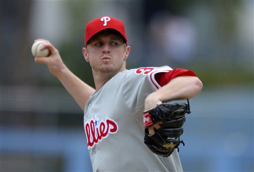 Philadelphia Phillies starting pitcher Kyle Kendrick throws to the plate during the first inning of their baseball game against the Los Angeles Dodgers, Sunday, June 30, 2013, in Los Angeles. (AP Photo/Mark J. Terrill)