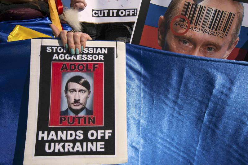 Posters showing Russian President Vladimir Putin are seen at an international protest during the Nuclear Security Summit at Malieveld in The Hague
