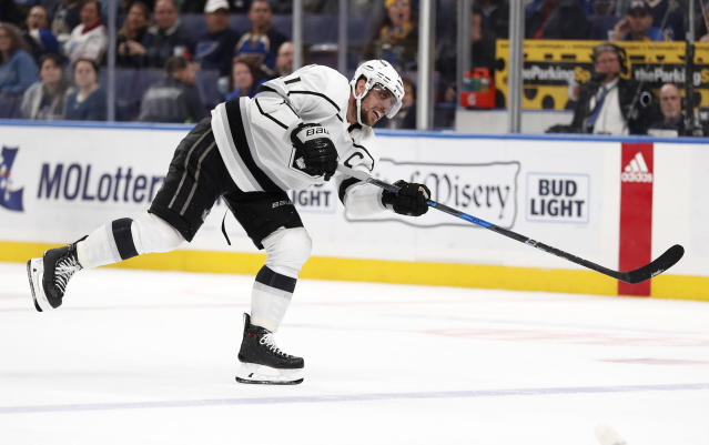 Los Angeles Kings' Anze Kopitar, of Slovenia, scores an empty-net goal during the third period of an NHL hockey game against the St. Louis Blues Monday, Nov. 19, 2018, in St. Louis. The Kings won 2-0. (AP Photo/Jeff Roberson)