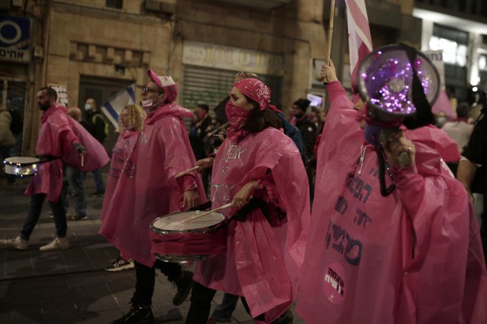 Protesters march on their way to Israeli Prime Minister Benjamin Netanyahu's official residence in Jerusalem, Saturday, Feb. 6, 2021. (AP Photo/Maya Alleruzzo)