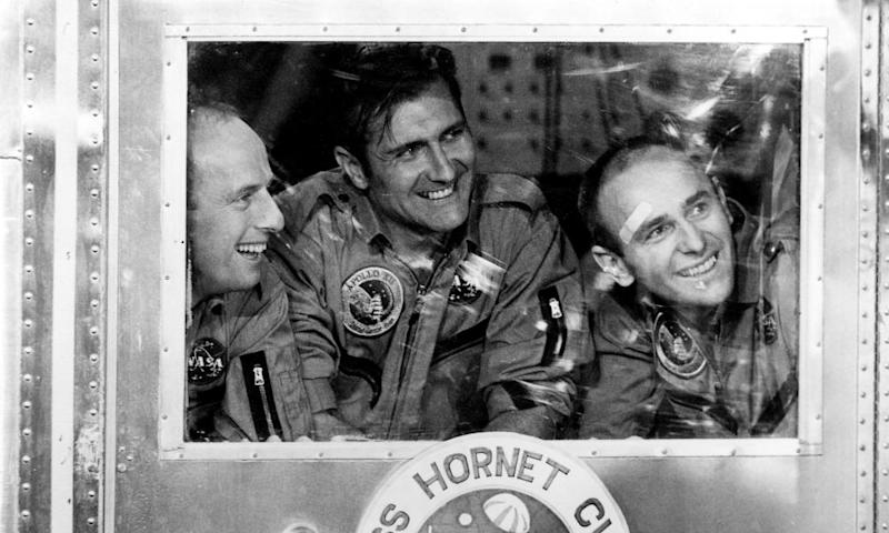 Richard Gordon, centre, with Pete Conrad, left, and Alan Bean in the quarantine capsule on board USS Hornet at the end of the Apollo 12 mission in 1969.