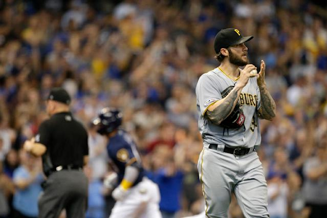Pittsburgh Pirates' Trevor Williams, right, reacts after giving up a solo home run to Milwaukee Brewers' Orlando Arcia during the second inning of a baseball game Sunday, Sept. 22, 2019, in Milwaukee. (AP Photo/Aaron Gash)