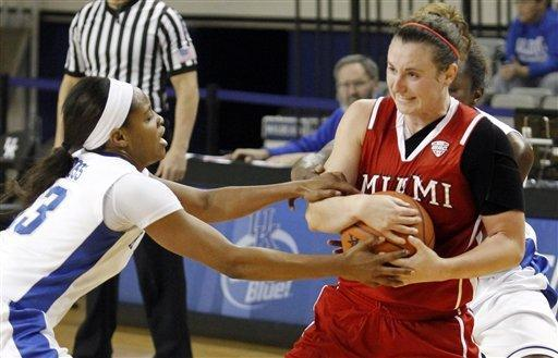 Kentucky's Bria Goss, left, and Samarie Walker, right, trap Miami (Ohio) guard Courtney Osborn during the first half of an NCAA college basketball game at Memorial Coliseum in Lexington, Ky., Wednesday, Nov. 28, 2012. (AP Photo/James Crisp)