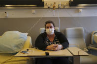 Lolita Andela who works as a carer for a disabled man sits in her hospital room on the eve of her surgery at Bichat Hospital, AP-HP, in Paris Tuesday, Dec. 1, 2020. Hospitals are increasingly grappling with giant backlogs of surgeries that were postponed when COVID-19 hit. To prevent the collapse of their public health systems, countries hard-hit by the virus in Europe prioritized virus patients and put off nonessential procedures, and even some essential ones. (AP Photo/Francois Mori)