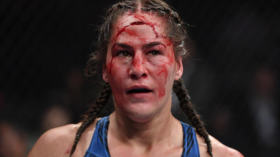 Blood, pictured here on the forehead of Jessica Eye after an accidental clash of heads with Jennifer Maia.