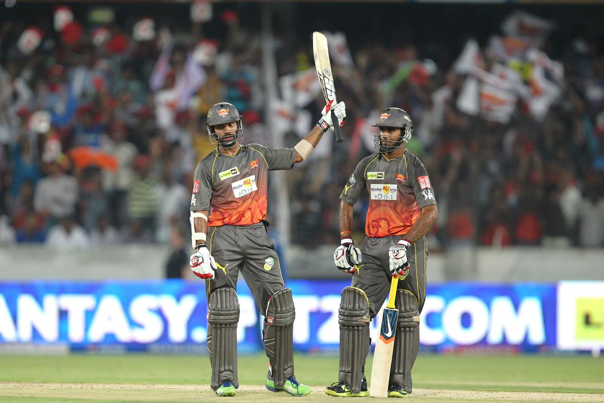 Shikhar Dhawan raises bat on completing the half century during match 43 of the Pepsi Indian Premier League between The Sunrisers Hyderabad and Mumbai Indians held at the Rajiv Gandhi International  Stadium, Hyderabad  on the 1st May 2013Photo by Prashant Bhoot-IPL-SPORTZPICS  Use of this image is subject to the terms and conditions as outlined by the BCCI. These terms can be found by following this link:https://ec.yimg.com/ec?url=http%3a%2f%2fwww.sportzpics.co.za%2fimage%2fI0000SoRagM2cIEc&t=1490456929&sig=TqAdXqnb7CwO3VEzIOh4ZA--~C
