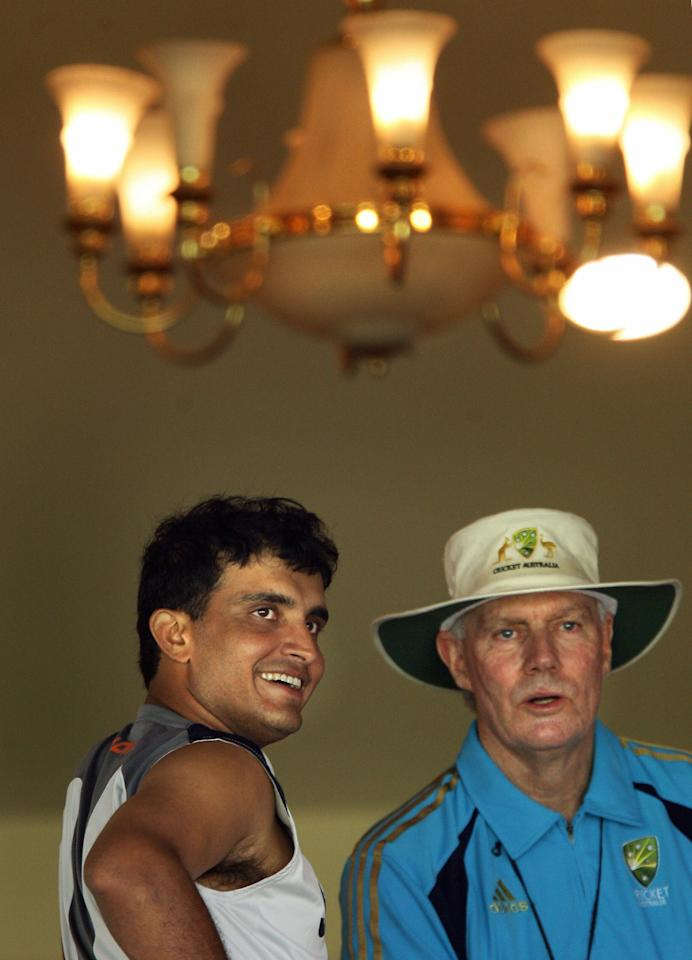 Indian cricketer Sourav Ganguly (L) speaks with Australian assistant coach and former Indian team coach Greg Chappell after attending a practice session at The Chinnaswamy Stadium in Bangalore on October 8, 2008.  India will play Australia in the first of a four match Test series for The Border-Gavaskar Trophy which will commence in the southern Indian city from October 9, 2008.     AFP PHOTO/Dibyangshu SARKAR (Photo credit should read DIBYANGSHU SARKAR/AFP/Getty Images)