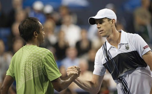 Sam Querrey, of the United States, right, shakes hands with Rajeev Ram, of the United States, after defeating him in a semifinals singles match at the Farmers Classic tennis tournament, Saturday, July 28, 2012, in Los Angeles. Querrey defeated Ram in the first two sets and will move onto Sunday's finals. (AP Photo/Grant Hindsley)