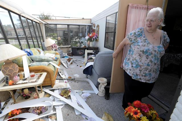 <p>Cherie Monroe stands in the sunroom of her home in the aftermath of Hurricane Matthew in the Tanglewood subdivision in Port Orange, Fla., Oct. 9, 2016. (Photo: Phelan Ebenhack/Reuters) </p>