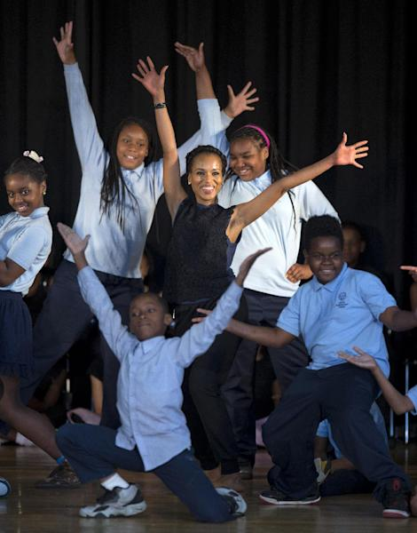 Actress Kerry Washington performs with students during a visit, along with first lady Michelle Obama, to Savoy Elementary School in Washington, Friday, May 24, 2013, in Washington. The Savoy School was one of eight schools selected last year for the Turnaround Arts Initiative at the President's Committee on the Arts and Humanities. Turnaround Arts Schools use the arts as a central part of their reform strategy to improve low performing schools (AP Photo/Evan Vucci)