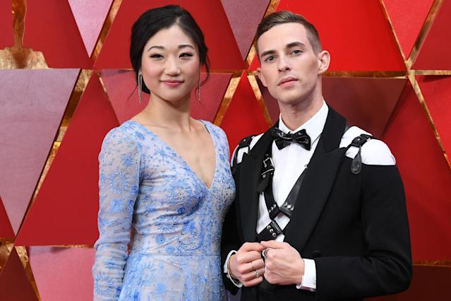 Adam Rippon rocked his bondage harness with Mirai Nagasu on the Academy Awards' red carpet. (ANGELA WEISS via Getty Images)