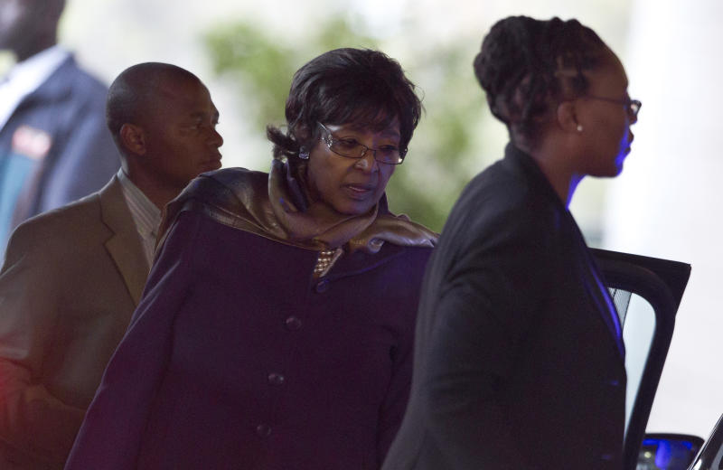 Former wife Winnie Madikizela-Mandela, center, arrives for a second time today at the Mediclinic Heart Hospital where former South African President Nelson Mandela is being treated in Pretoria, South Africa Wednesday, June 26, 2013. There was no word early Wednesday on 94-year-old Mandela's condition, which was critical a day earlier, according to the government. (AP Photo/Ben Curtis)