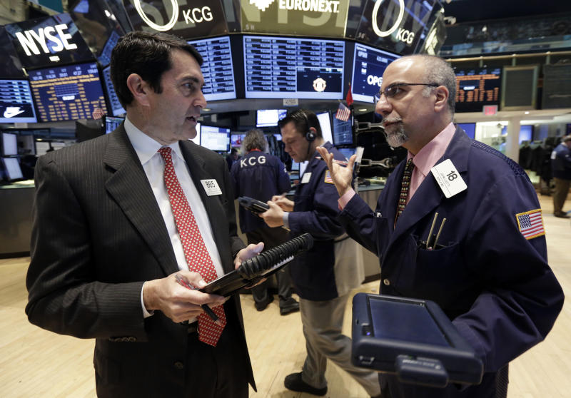 Traders Mark Muller, left, and John Liotti, right, work on the floor of the New York Stock Exchange, Monday, April 7, 2014. Stocks are starting out the week the same way they ended the last one, down. (AP Photo/Richard Drew)