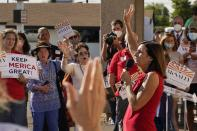 """Arizona Republican Sen. Martha McSally sings """"God Bless America"""" as she campaigns at Arizona Republican Party Headquarters Monday, Nov. 2, 2020, in Phoenix. McSally is running against Democratic candidate Mark Kelly in the election set for tomorrow. (AP Photo/Ross D. Franklin)"""