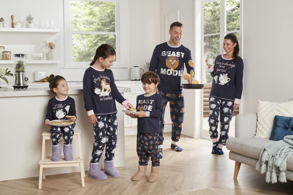 family dressed in matching big w Beauty and the Beast PJ sets