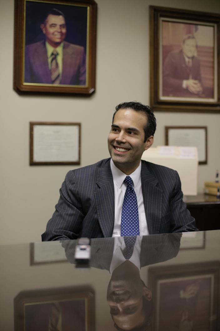 """In this Nov. 19, 2013 photo, George P. Bush, the grandson of one former president and nephew of another, visits the Republican Party of Texas headquarters where he formally filed to run for Texas land commissioner, in Austin, Texas. Bush will face former El Paso Democratic Mayor John Cook in next November's election. Rather than campaigning on the mainstream Republicanism embodied by the family name, Bush says he's """"a movement conservative"""" more in line with the tea party. (AP Photo/Eric Gay)"""
