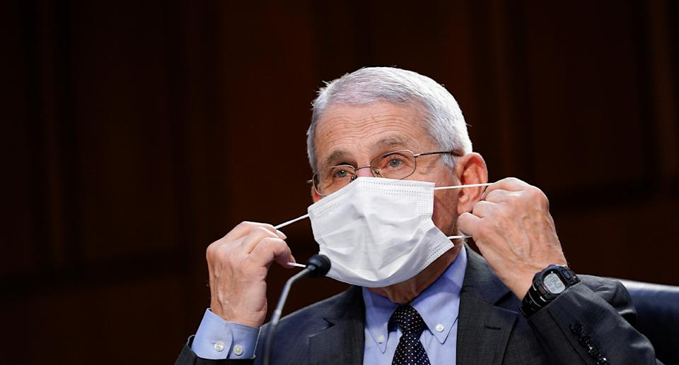 Dr Anthony Fauci, director of the National Institute of Allergy and Infectious Diseases, adjusts his protective mask during a US Senate Health, Education, Labor, and Pensions Committee hearing to examine the COVID-19 response on Capitol Hill in Washington, USA, March 18, 2021. Photo: Reuters